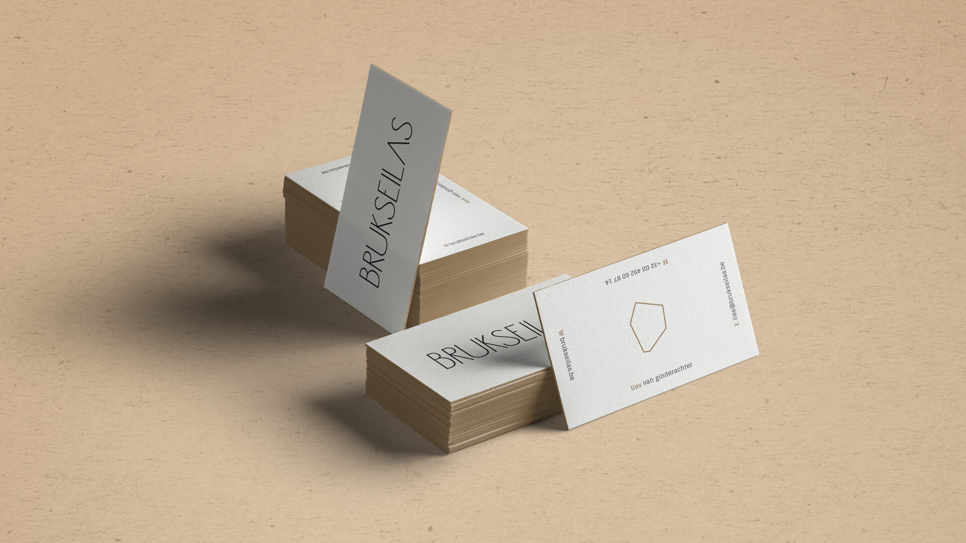 Mockup of Business Cards for Brukseilas on beige Background