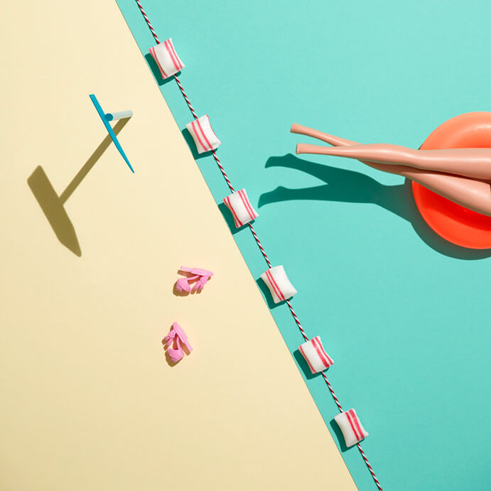 Photo styled by Lies Van Ginderachter with Barbie Legs, coloured Background and bathing Accessories