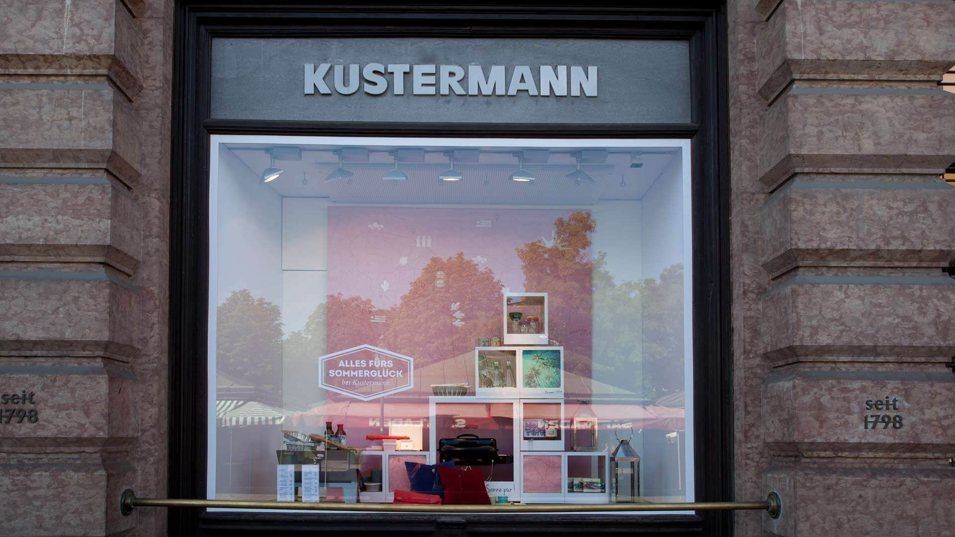 Photo of the Kustermann Store Window with Illustrated Background