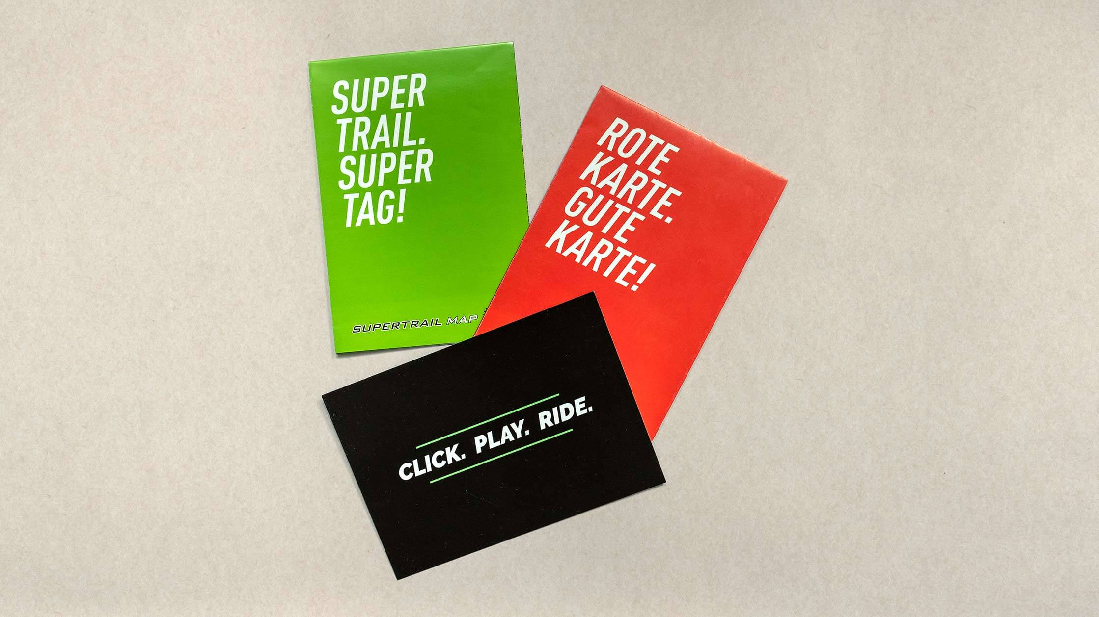 Photo of a green, red and black Flyer for Supertrail Guide, Freeride Map and Supertrail Map