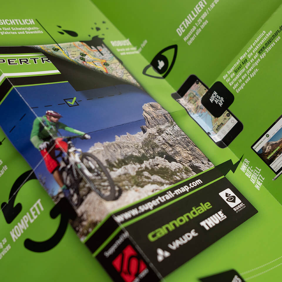 Closup of Mockup of a green Supertrail Map Folded Flyer