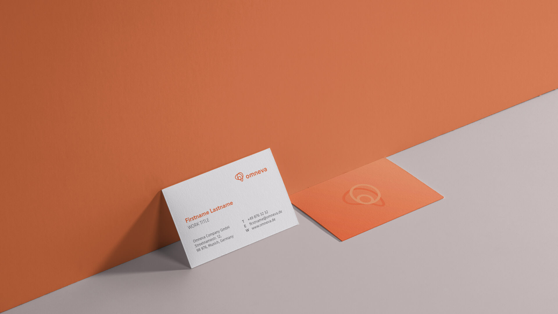 Mockup with Business Cards for omneva in an orange Setting
